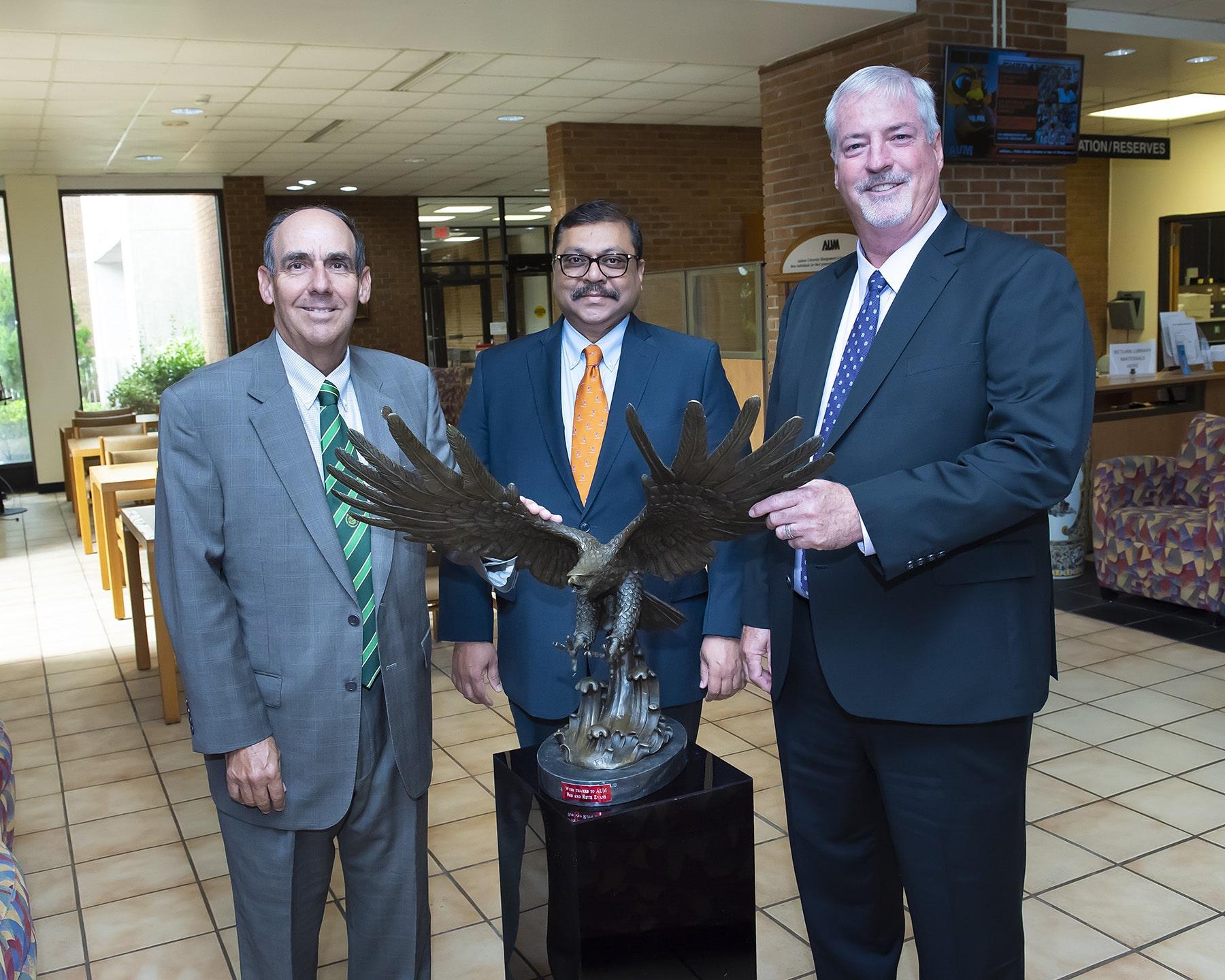 Retired professor gifts Warhawk statue to AUM